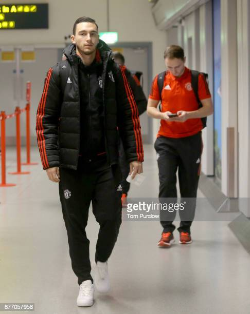 Matteo Darmian of Manchester United checks in ahead of their flight to Basel at Manchester Airport on November 21 2017 in Manchester England