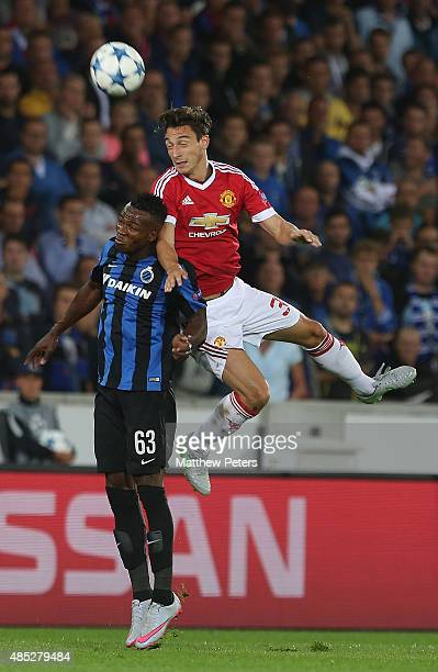 Matteo Darmian of Manchester United in action with Bolingoli Mbombo of Club Brugge during the UEFA Champions League playoff second leg match between...