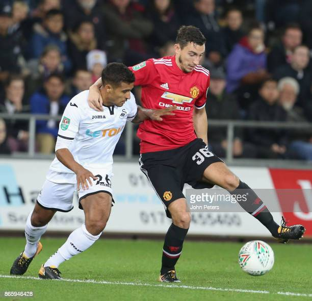 Matteo Darmian of Manchester United in action with Kyle Naughton of Swansea City during the Carabao Cup Fourth Round match between Swansea City and...
