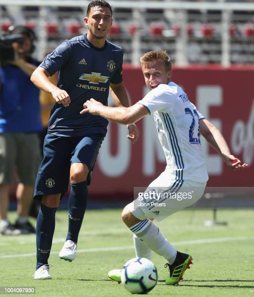 Matteo Darmian of Manchester United in action with Tommy Thompson of San Jose Earthquakes during the preseason friendly match between Manchester...