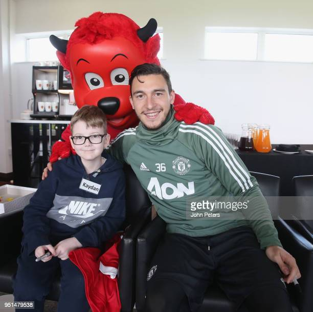 Matteo Darmian of Manchester United poses with Kayden during the MU Foundation Dream Day at Aon Training Complex on April 26 2018 in Manchester...
