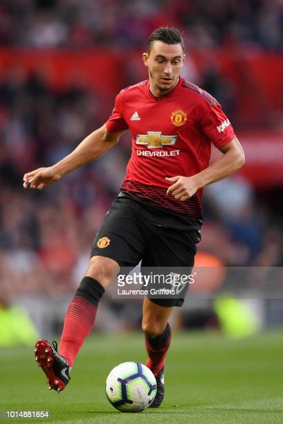Matteo Darmian of Manchester United runs with the ball during the Premier League match between Manchester United and Leicester City at Old Trafford...