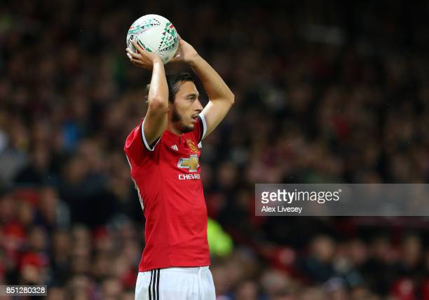 Matteo Darmian of Manchester United takes a throw in during the Carabao Cup Third Round match between Manchester United and Burton Albion at Old...