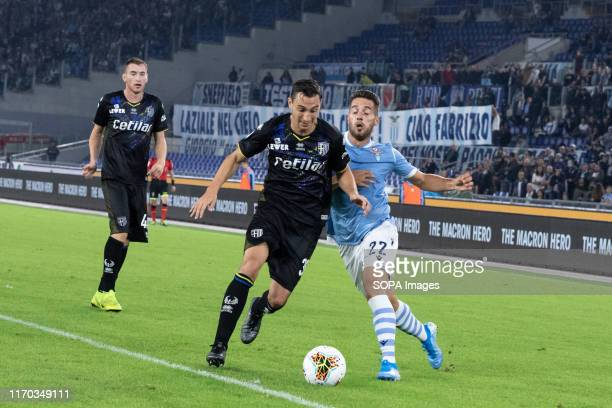 Matteo Darmian of Parma and Jonathan Rodriguez Menendez of Lazio are seen in action during the Serie A match between Lazio and Parma at Olimpico...