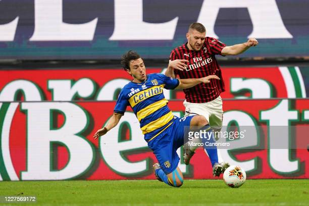 Matteo Darmian of Parma Calcio and Ante Rebic of Ac Milan in action during the Serie A match between Ac Milan and Parma Calcio. Ac Milan wins 3-1...