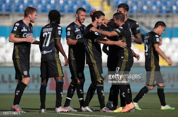 Matteo Darmian of Parma Calcio celebrates with his teammates after scoring the opening goal during the Serie A match between Brescia Calcio and Parma...