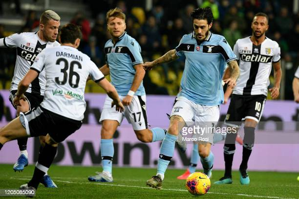 Matteo Darmian of Parma Calcio competes for the ball with Luis Alberto of SS Lazio during the Serie A match between Parma Calcio and SS Lazio at...