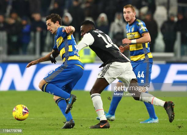 Matteo Darmian of Parma Calcio is challenged by Blaise Matuidi of Juventus FC during the Serie A match between Juventus and Parma Calcio at Allianz...