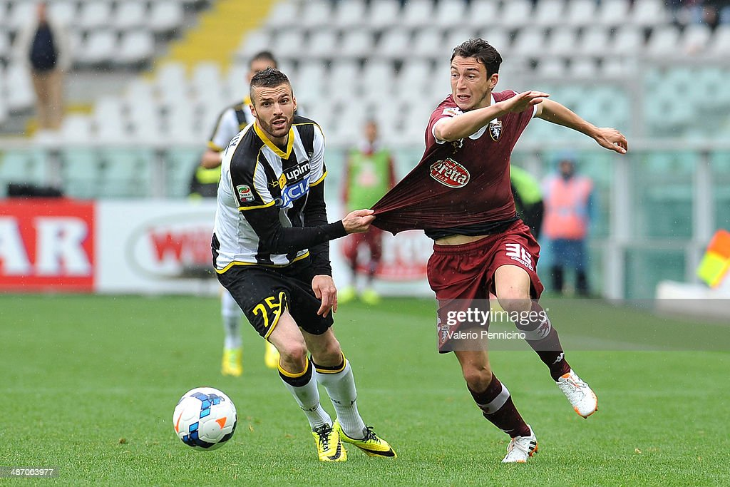 Matteo Darmian (R) of Torino FC is pulled by his shirt by Thomas Heurtaux of Udinese Calcio during the Serie A match between Torino FC and Udinese Calcio at Stadio Olimpico di Torino on April 27, 2014 in Turin, Italy.