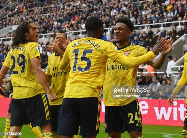Matteo Guedouzi Ainsley MaitlandNiles and Reiss Nelson celebrate the Arsenal goal during the Premier League match between Newcastle United and...