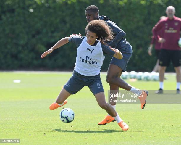 Matteo Guendouzi and Chuba AKpom of Arsenal during a training session at London Colney on July 12 2018 in St Albans England