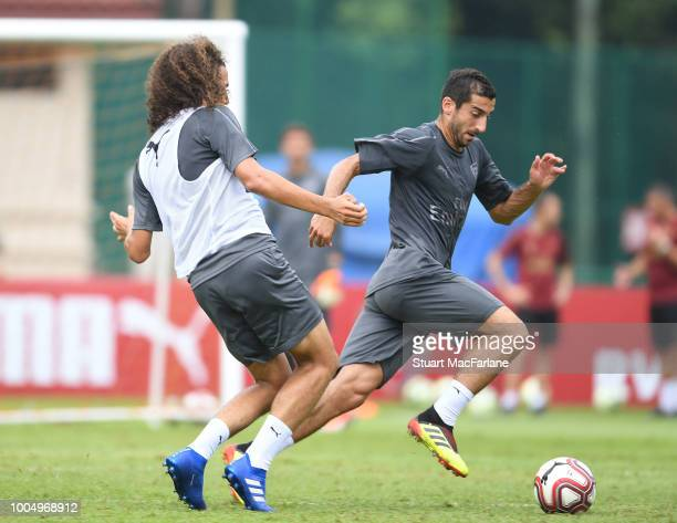 Matteo Guendouzi and Henrikh Mkhitaryan of Arsenal during a training session at Singapore American School on July 25 2018 in Singapore