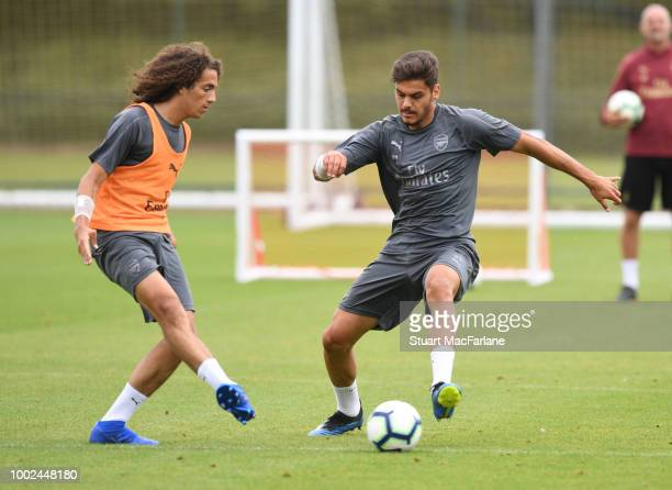 Matteo Guendouzi and Konstantinos Mavropanos of Arsenal during a training session at London Colney on July 20 2018 in St Albans England