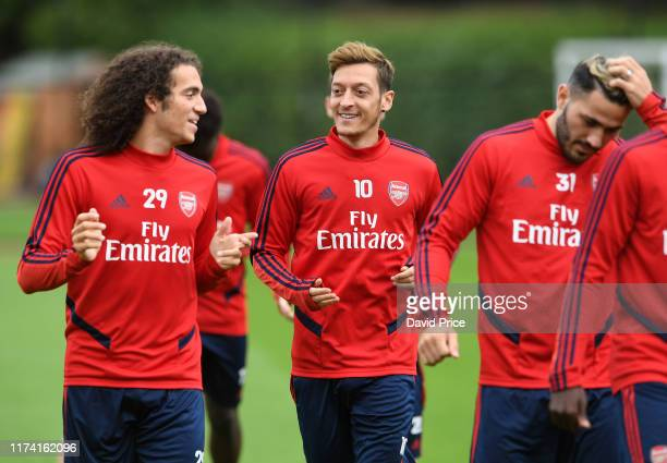 Matteo Guendouzi and Mesut Ozil of Arsenal during the Arsenal Training Session at London Colney on September 12 2019 in St Albans England