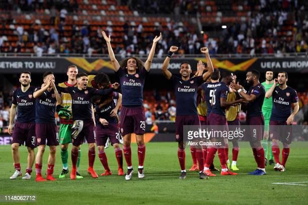 Matteo Guendouzi and PierreEmerick Aubameyang of Arsenal celebrate victory with teammates after the UEFA Europa League Semi Final Second Leg match...