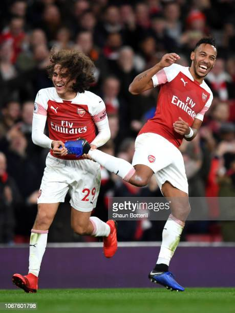 Matteo Guendouzi grabs the boot of Pierre-Emerick Aubameyang of Arsenal during the Premier League match between Arsenal FC and Tottenham Hotspur at...