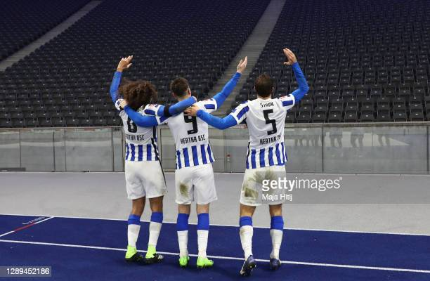 Matteo Guendouzi, Krzysztof Piatek and Niklas Stark of Hertha celebrate with imaginary fans in front of the empty stand after winning the Bundesliga...