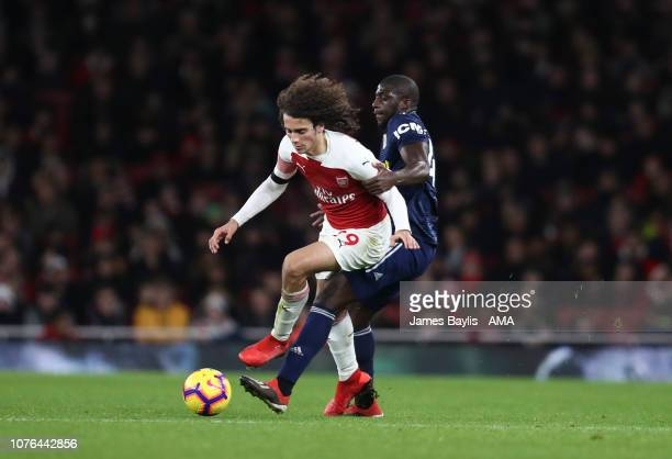 Matteo Guendouzi of Arsenal and Aboubakar Kamara of Fulham during the Premier League match between Arsenal FC and Fulham FC at Emirates Stadium on...