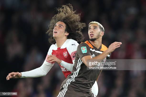 Matteo Guendouzi of Arsenal and Said Benrahma of Brentford look up for the ball during the Carabao Cup Third Round match between Arsenal and...