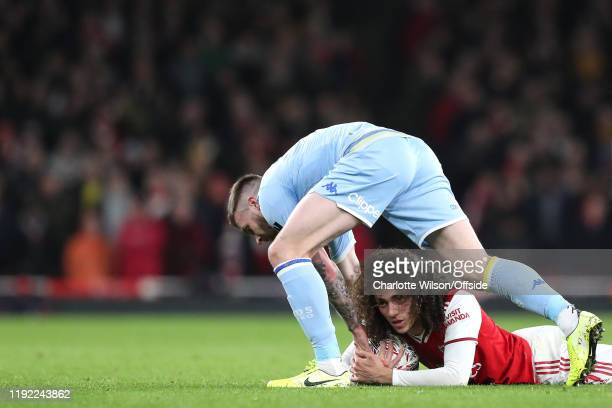 Matteo Guendouzi of Arsenal and Stuart Dallas of Leeds become entangled after falling during the FA Cup Third Round match between Arsenal and Leeds...