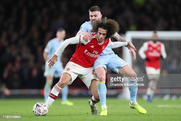 Matteo Guendouzi of Arsenal and Stuart Dallas of Leeds during the FA Cup Third Round match between Arsenal and Leeds United at Emirates Stadium on...