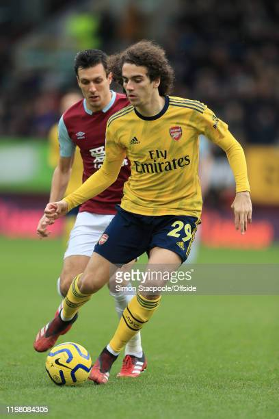 Matteo Guendouzi of Arsenal battles with Jack Cork of Burnley during the Premier League match between Burnley FC and Arsenal FC at Turf Moor on...