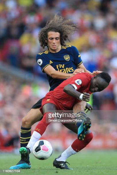 Matteo Guendouzi of Arsenal battles with Sadio Mane of Liverpool during the Premier League match between Liverpool and Arsenal at Anfield on August...