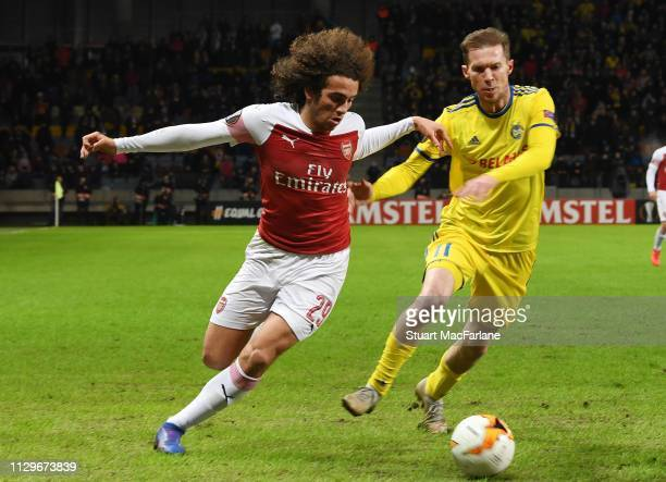 Matteo Guendouzi of Arsenal breaks past Aleksandr Helb of BATE during the UEFA Europa League Round of 32 First Leg match between BATE Borisov and...