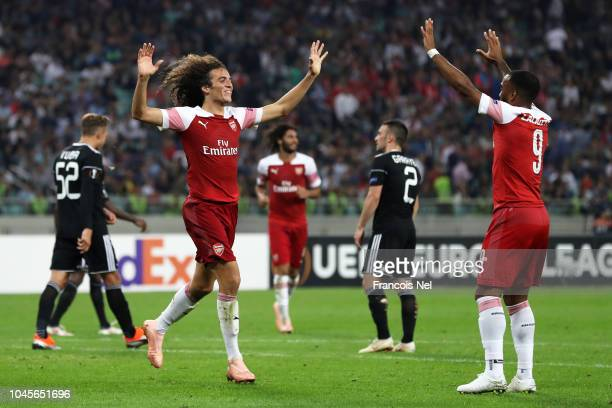 Matteo Guendouzi of Arsenal celebrates with teammate Alexandre Lacazette after scoring his team's third goal during the UEFA Europa League Group E...