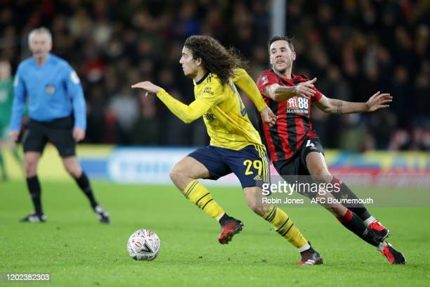 Matteo Guendouzi of Arsenal competes for the ball with Dan Gosling of Bournemouth during the FA Cup Fourth Round match between Bournemouth and...