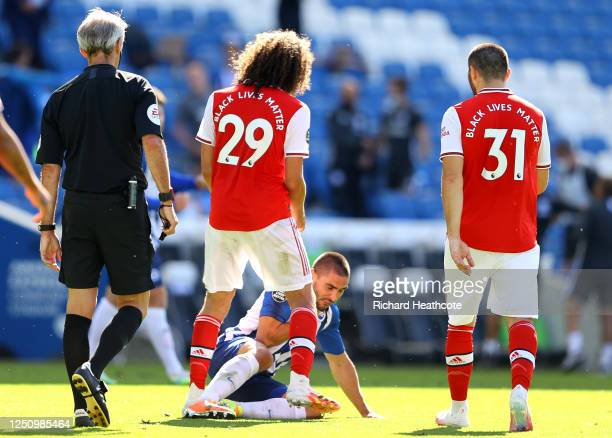 Matteo Guendouzi of Arsenal confronts Neal Maupay of Brighton and Hove Albion during the Premier League match between Brighton Hove Albion and...
