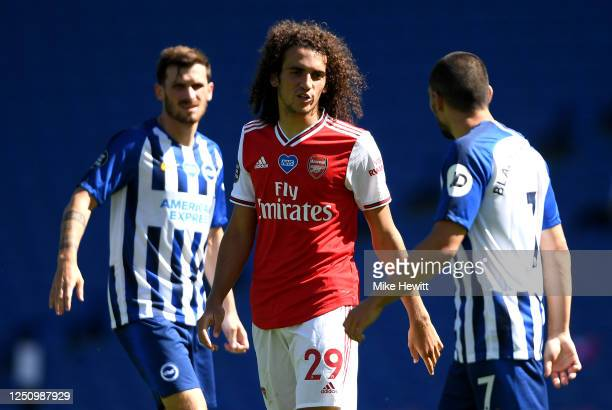 Matteo Guendouzi of Arsenal confronts Neal Maupay of Brighton and Hove Albion during the Premier League match between Brighton & Hove Albion and...