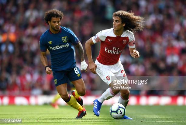 Matteo Guendouzi of Arsenal controls the ball as Felipe Anderson of West Ham United looks on during the Premier League match between Arsenal FC and...