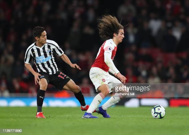 Matteo Guendouzi of Arsenal gets past Yoshinori Muto of Newcastle United during the Premier League match between Arsenal FC and Newcastle United at...