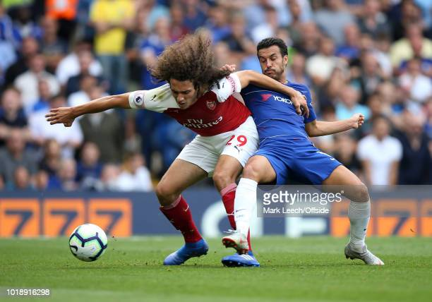 Matteo Guendouzi of Arsenal holds off the challenge of Pedro of Chelsea during the Premier League match between Chelsea FC and Arsenal FC at Stamford...