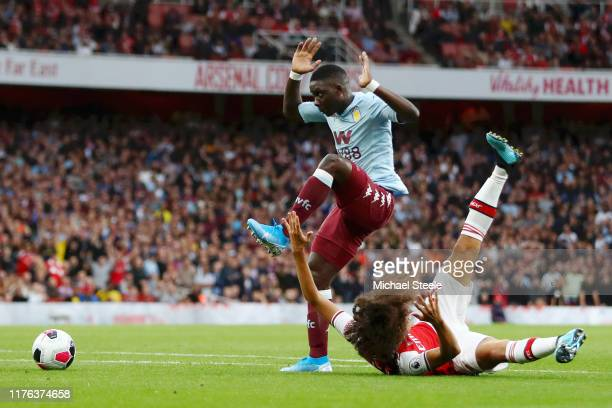 Matteo Guendouzi of Arsenal is brought down by Marvelous Nakamba of Aston Villa leading to a penalty during the Premier League match between Arsenal...