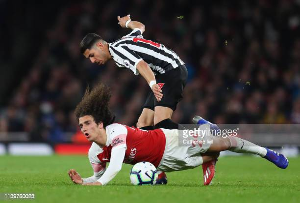 Matteo Guendouzi of Arsenal is challenged by Ayoze Perez of Newcastle United during the Premier League match between Arsenal FC and Newcastle United...