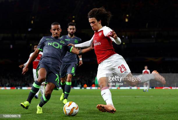 Matteo Guendouzi of Arsenal is challenged by Bruno Gaspar of Sporting CP during the UEFA Europa League Group E match between Arsenal and Sporting CP...