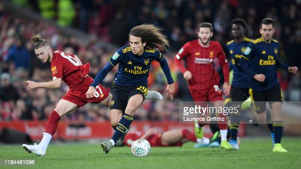Matteo Guendouzi of Arsenal is challenged by Harvey Elliott of Liverpool during the Carabao Cup Round of 16 match between Liverpool and Arsenal at...