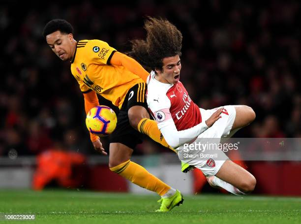 Matteo Guendouzi of Arsenal is fouled by Helder Costa of Wolverhampton Wanderers during the Premier League match between Arsenal FC and Wolverhampton...