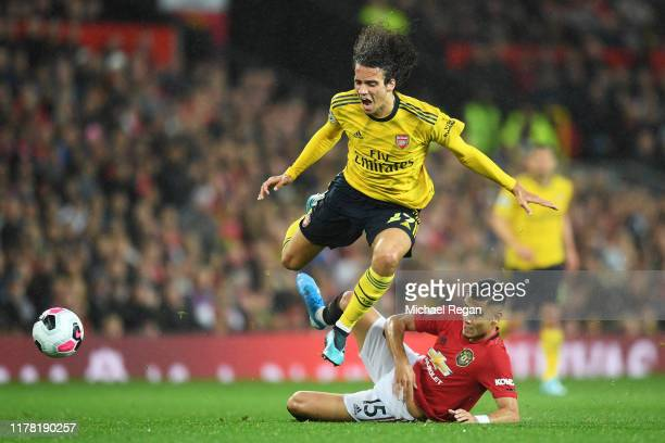 Matteo Guendouzi of Arsenal is tackled by Andreas Pereira of Manchester United during the Premier League match between Manchester United and Arsenal...