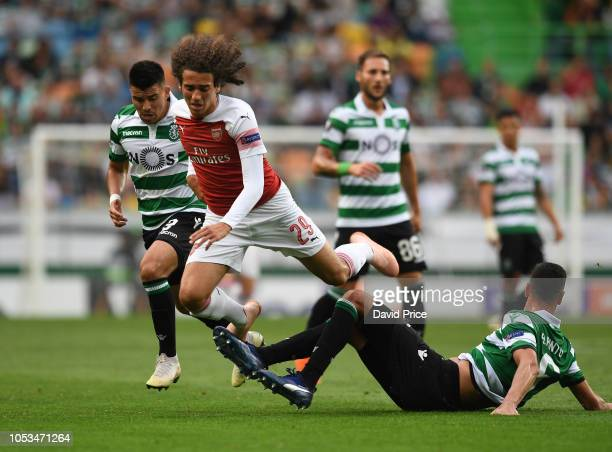 Matteo Guendouzi of Arsenal is tripped by Andre Pinto of Sporting during the UEFA Europa League Group E match between Sporting CP and Arsenal at...
