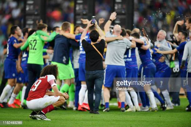Matteo Guendouzi of Arsenal looks dejected as the Chelsea players and staff celebrate behind during the UEFA Europa League Final between Chelsea and...