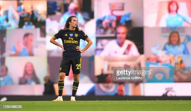 Matteo Guendouzi of Arsenal shows his frustration in front of an interactive fan screen after Raheem Stirling scored the opening goal during the...