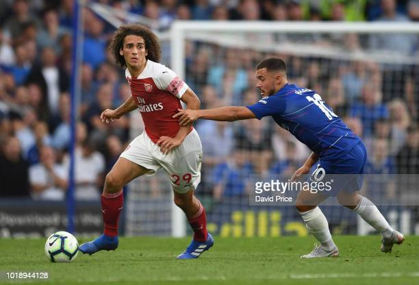 Matteo Guendouzi of Arsenal takes on Eden Hazard of Chelsea during the Premier League match between Chelsea FC and Arsenal FC at Stamford Bridge on...