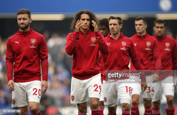 Matteo Guendouzi of Arsenal walks out with his teammates before the Premier League match between Chelsea FC and Arsenal FC at Stamford Bridge on...