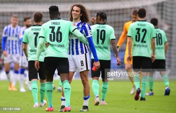 Matteo Guendouzi of Hertha Berlin interacts with Breel Embolo of Borussia Moenchengladbach after the Bundesliga match between Hertha BSC and Borussia...