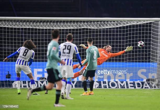 Matteo Guendouzi of Hertha Berlin scores their team's first goal past Ralf Fahrmann of FC Schalke 04 during the Bundesliga match between Hertha BSC...