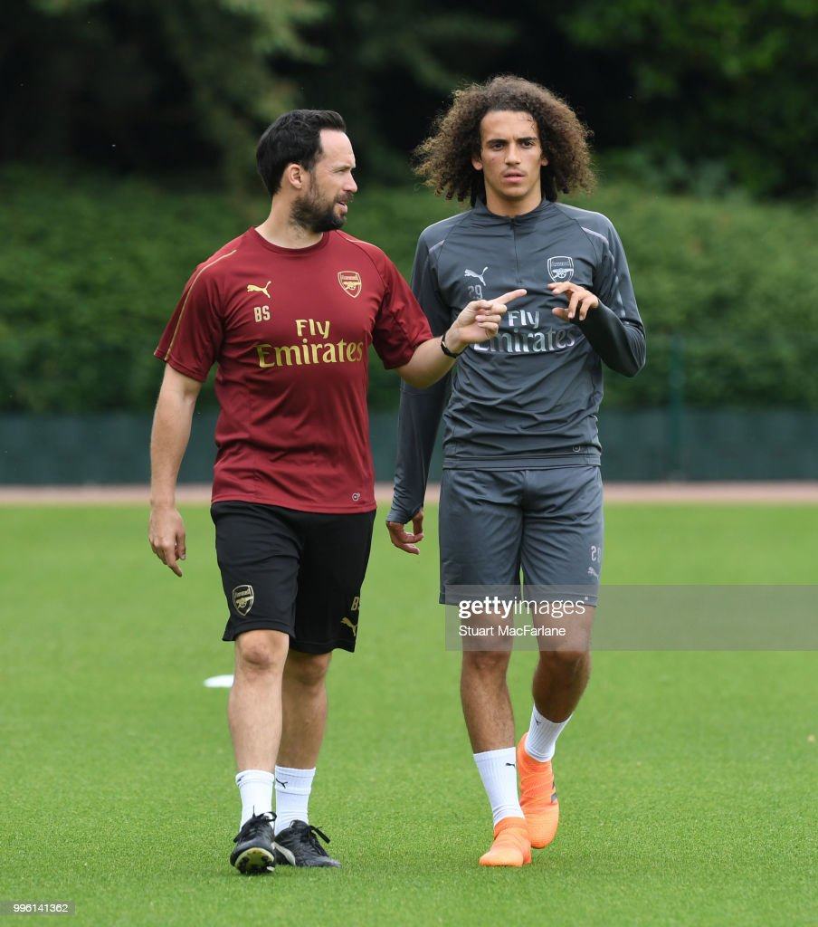 Matteo Guendouzi with Arsenal fitness coach Barry Solan during a training session at London Colney on July 11, 2018 in St Albans, England.