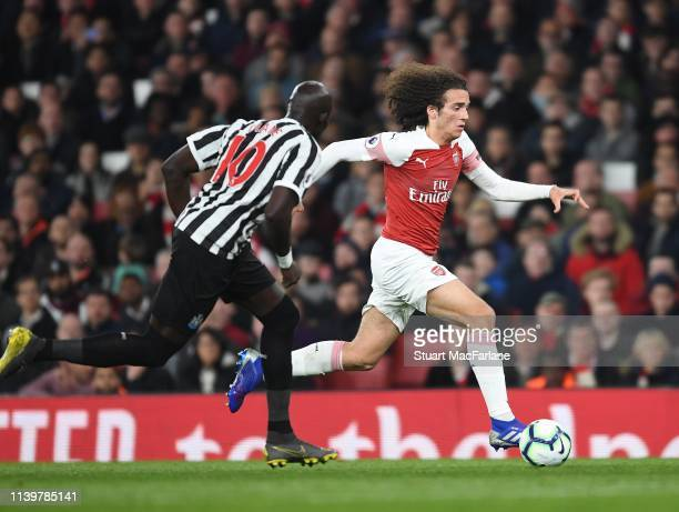 Matteo Gunedouzi of Arsenal breaks past Mo Diame of Newcastle during the Premier League match between Arsenal FC and Newcastle United at Emirates...